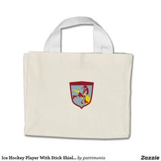 Ice Hockey Player With Stick Shield Retro Mini Tote Bag. Retro mini tote bag showing an illustration of an ice hockey player skating with stick set inside a shield done in retro style. #icehockey #olympics #sports #summergames #rio2016 #olympics2016