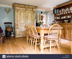 Wheel Back Chairs And Pine Table In Country Dining Room With Large