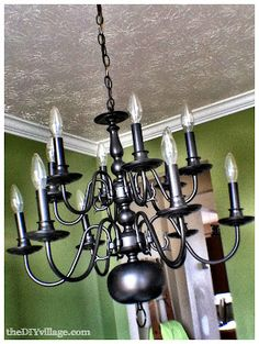 painted brass chandelier-- perhaps a crafty way to not have to buy a monster foyer light??