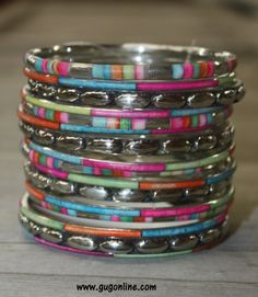 Gypsy Soule Set of 16 Silver and Colorful Bangle Bracelets www.gugonline.com Price:$32.95