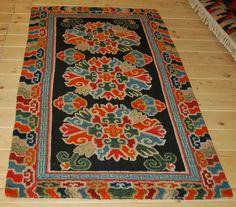 Woollen Khaden carpet, the black field with peonies, Ruji clouds design at the borders. Tibet 1800 Measure cm. 80 x 160