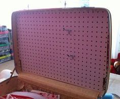 Craft Show displays made from Vintage Suitcases - pegboard adds hanging space.