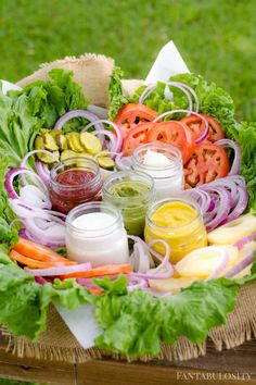 "What a classy way to serve the toppings for a burger bar!Burger Bar Ideas: Toppings ideas and a food bar that you and your guests will love at your next party! Plus, a free ""Burger Bar"" printable for your table! Party Food Platters, Party Trays, Snacks Für Party, Lunch Party Ideas, Party Food Bars, Party Food Buffet, Fruit Platters, Parties Food, Birthday Cookout Ideas"