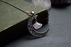 Hey, I found this really awesome Etsy listing at https://www.etsy.com/listing/266750714/crescent-moon-silver-filigree-with-raw