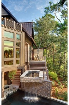 A modern pool by The Anderson Studio of Architecture & Design ~ An interpretation of FLW's Falling Water? What do you think?