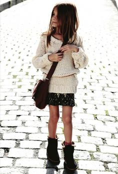 Evangeline enjoys walking down the street looking at the shops.