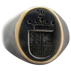 Bold and handsome Victorian signet ring of steel enhanced with gold. The crest on the Portuguese coat of arms is a crown implying nobility. These rings were originally used to officially mark a document. The ring is a size 9 and measures at its widest. Antique Gold Rings, Vintage Rings, Antique Jewelry, Ring Bear, Gold Crown, Ancient Jewelry, Signet Ring, Coat Of Arms, Yellow Gold Rings
