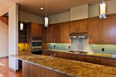 Cabinets and Trim above cabinets    Oglesby·Greene Designed Texas Modern Home