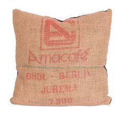 """Canvas 'Amacafe' coffee bag upcycled into pillow. Includes a black faux silk back and down insert.  Product: PillowConstruction Material: Canvas, faux silk and downColor: Tan, red and blackFeatures: Insert includedDimensions: 22"""" x 22""""Note: Due to the vintage nature of this product, some wear and tear is to be expected. Products may show signs of brand marks, scrapes or other blemishes.Cleaning and Care: Wipe with damp cloth"""