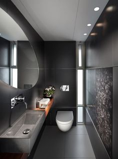 16 Almost Pure Black Bathroom Design Ideas : Small Bathroom With Black Wall Color And Rectangle Sink With Oval Mirror Design Bathroom Trends, Bathroom Interior, Design Bathroom, Bathroom Ideas, Sink Design, Bathroom Layout, Bath Ideas, Bathroom Mural, Ikea Interior