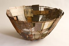 Patch Basket by John Garrett. Steel armature, found and collected steel and copper sheets, crocheted copper wire, paper