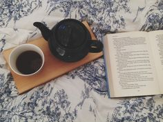 spending the day with a pot of tea in bed.