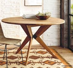 Roost Recycled Teak Table - The contemporary design of this recycled teak table, juxtaposes a circular top with aesthetically pleasing angles. A sculptural iron brace connects the angled legs. Handcrafted from recycled teak from Japanese houses, this tables never fails to impress. Seats up to six.
