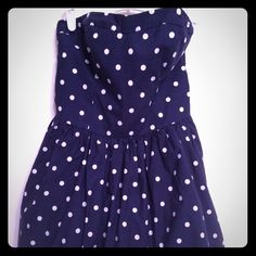 Hollister Ruffled Polka Dot Mini Dress This sweet mini dress is perfect for spring or summer! The bodice has boning and tailoring on the cups so you can wear it without a bra, and the back has elastic to keep it snug. It has loops for a sash or belt (not included). Such a cute dress, but too small for me now! Size L in juniors but fits like a 0 or 2. Hollister Dresses Mini