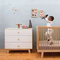 This dresser and crib combo make the room feel light and effortless!