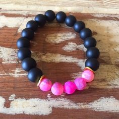Sale- Matte black and pink beaded bracelet Matte black beads strung with pink frosted agate on elastic cord, measures 7 inches around Immeasurably More Jewelry Bracelets