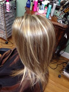 Highlights and Lowlights with long layered haircut.