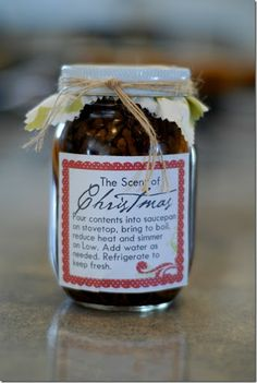 DIY ~~ The Scent Of Christmas Gift-In-A-Jar - citrus slices, cinnamon sticks & spices in a jar, topped & labeled. Great gift idea.