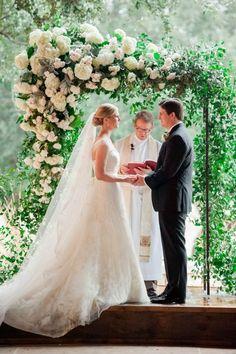 Elegant ceremony arch with flowers   Image by Jennifer Lindberg Weddings