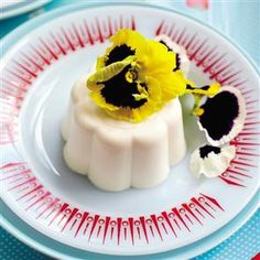 Creamy Lemon Blancmange with a touch of rum and garnished with edible pansy blossoms...