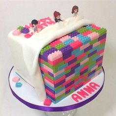 Such a colourful idea, but quite time consuming as each brick needs to be moulded individually. If you could provide the characters I could do a cake like this for £60 or I can make sugarpaste characters for £7 each.