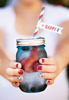 "Red, White  Berry Water in Blue Mason Jars for a ""All-American County Fair"" 4th of July Party"