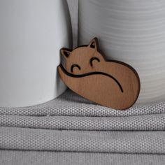 Origami Fox only €12.95 from ArtySmartyShop.com  This origami style brooch is made from wood and finished with a durable varnish. There are also matching necklaces, to go with these brooches.  #artysmarty #womensfashion #fashionbloggers #unique #handmadejewelry