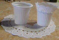 A coffee creamer container and the rest of the dollar store doily for trim and you have a cute wastebasket. Many other rubish to minitures on site.