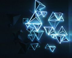 """This is """"maptriangle"""" by Mathilde Lier on Vimeo, the home for high quality videos and the people who love them. Interactive Installation, Light Installation, Stage Design, Event Design, Triangular Architecture, Origami Lights, Origami Wall Art, Nightclub Design, Geometric Origami"""