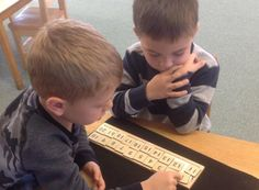 Putting the numbers on the 20's board and then count together. #PreschoolMathematics