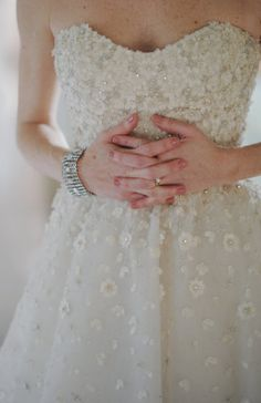 the floral detail on this dress is just beyond