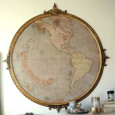 A huge, antique map in a great frame. This is amazing. One can dream!