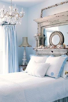 I love the chandelier and the antique mantle headboard. This is a fresh color pallet for a person with no children or pets lol