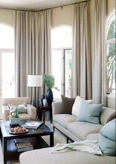 soft, soothing neutrals and draperies hanging from ceiling height