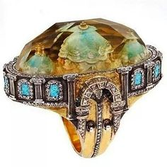 Sevan Bicakci one-of-a-kind gold and sterling silver ring featuring an inversely carved citrine centre stone representing Turkish architecture (the Blue Mosque) surrounded by diamonds.