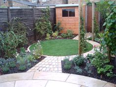 Raised brick planters and limestone paving replace lawn to create an easy to maintain garden of year round interest. Description from gardens2wish4.co.uk. I searched for this on bing.com/images