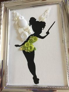 Canvas board with hand painted Tinkerbell silhouette and button art. Size is 5 x 7 inches and comes with the frame pictured. Frame back has stand to self stand or hook for hanging if desired. Frame has slight scratch on right side (see last picture) price is adjusted to compensate for this.