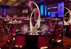 Unconventional centerpieces using vases, orchids and crystals