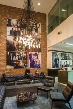 Warner Music – London Headquarters bespoke chandelier made of glass bulbs and microphone
