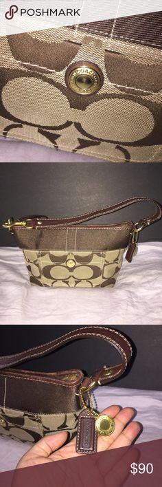 ‼️Authentic Coach Signature Shoulder Bag‼️ Lo771-11688 authentic Coach signature small hobo shoulder bag mahogany brown. Slightly used have a few stains on the in and outside of it but still in good condition!! Don't come with the cover bag. Coach Bags