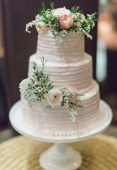 Pink and white flowers atop a white cake // Kiel Rucker Photography