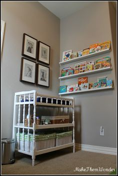 Changing table and floating bookshelves