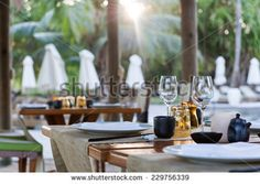 Close Up of Table Place Settings at Outdoor Poolside Asian Restaurant - stock photo