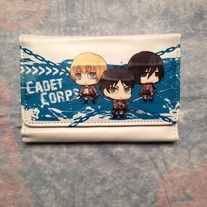 Attack on Titan wallet, perfect for anything that goes in a wallet. It even has Eren Mikassa, and Armin , what more can you ask for?