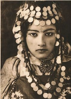 This photograph of a probably newly married, Ouled Naïl Algerian girl was taken (by Lehnert and Landrock) in 1905