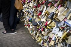 "Pont Des Arts, where visitors have taken to attaching ""love"" locks & throwing away the key to symbolize commitment. #Paris"
