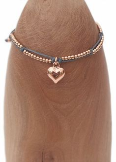 Rose gold effect heart on grey cord £13.95