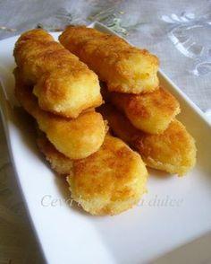Reteta culinara Crochete de cartofi din categoria Aperitive / Garnituri. Cum sa faci Crochete de cartofi
