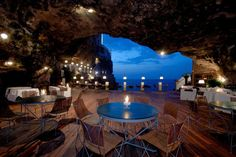 Grotta Palazzese hotel restaurant is set in a vaulted limestone cave in the town of Polignano a Mare in Southern Italy.