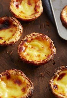 """Pastel de nata"" This is the authentic Portuguese Custard Tarts recipe, used by a bakery in Lisbon. Use the 6 tips provided in the recipe to make a perfectly crisp and nicely browned custard tart without hassle. Portugese Custard Tarts, Portuguese Custard Tart Recipe, Egg Custard Tart Recipe, Tart Recipes, Sweet Recipes, Baking Recipes, Dessert Recipes, Dessert Tarts, Egg Yolk Recipes"